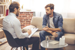 man talking to clinician