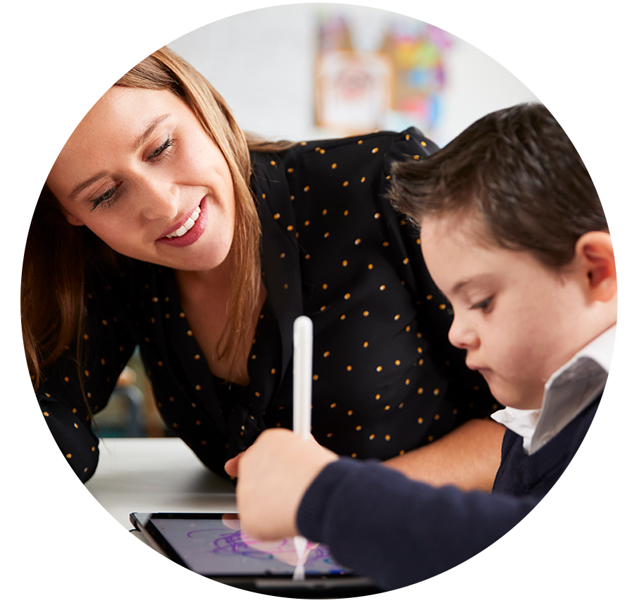 woman watching child draw on tablet
